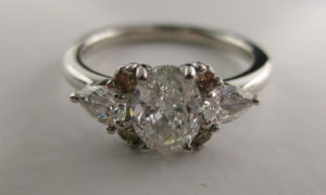 vintage diamond trilogy engagement ring