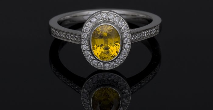 yellow diamond halo platinum engagement ring