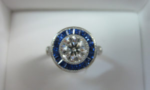 Round brilliant cut halo sapphire engagement ring