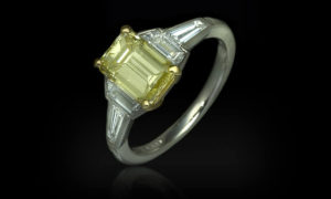 GIA certified emerald cut yellow diamond set in platinum